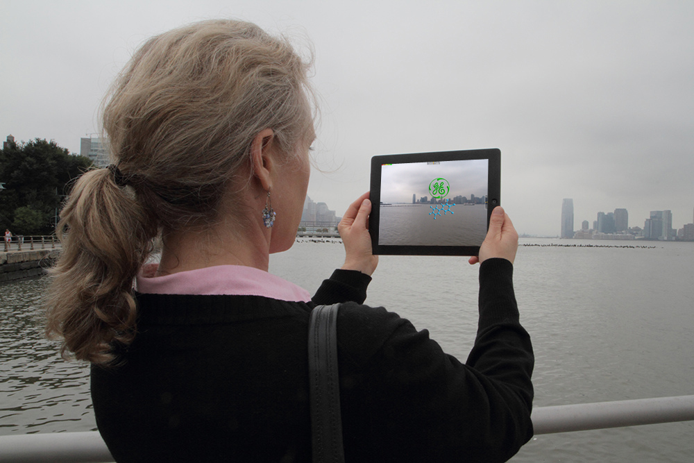 Looking at the Hudson River as a PCB molecule and the GE symbol float down